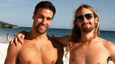 Endicott Ackerman, 20, (left) is missing after he was spotted diving into rough seas at Bondi Beach on Monday.