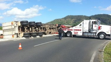 Watermelons spill down a grassy verge after a truck crashed north of Cairns.