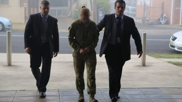 An Australian Defence Force airwoman was arrested on Thursday over an alleged bank robbery.