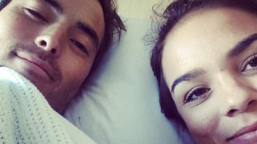 Mathew Lee, pictured in hospital with his girlfriend, Suzy Gerada.