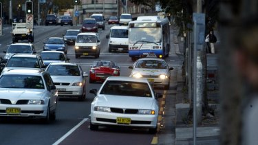 Speed increase expected: a bus travels along Parramatta Road near Broadway.