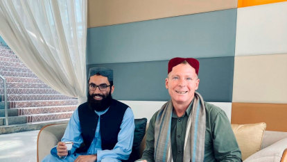 Unlikely photo of Australian ex-captive sitting with ex-terror detainee tweeted by Taliban