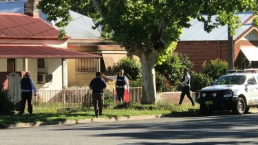 Police search a house in Gurwood Street, Wagga Wagga, where a 19-year-old man was arrested on Tuesday evening.