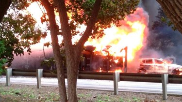 Fireball: The tanker lies on its side engulfed by flames.