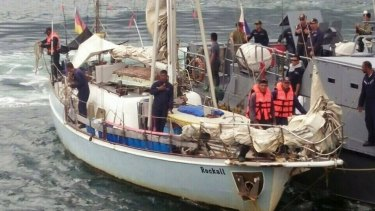 """Philippine Navy personnel board the yacht """"Rockall"""" after it was found abandoned in the Sulu Sea in southern Philippines over the weekend."""