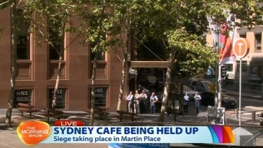 Police with guns drawn in Martin Place in a screengrab.