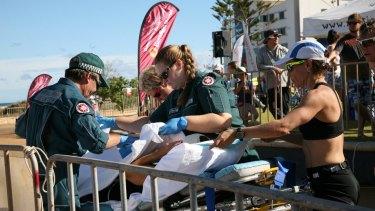 Raija Ogden is taken away on a stretcher.