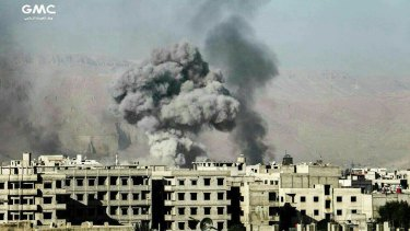 Smoke and debris rise after Syrian government air strikes hit Eastern Ghouta, near Damascus, last week.