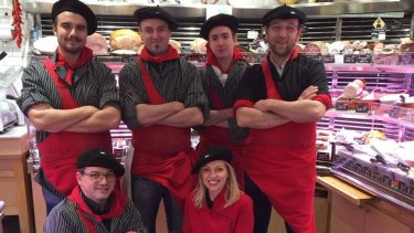 """The team at the Boucherie Basque """"l'ami Txulette"""" in Paris. The butchers have now added a vending machine to the outside of their shop."""