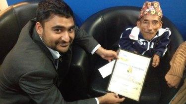 Amarjhit Khela presents a certificate of appreciation to Chandra Bahadur Dangi.