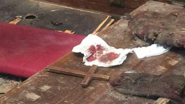 Blood and debris in the aftermath of the blast at the church of St Peter and St Paul in Cairo.