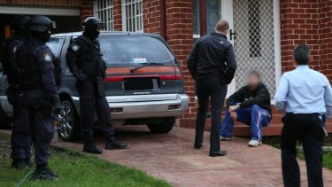 The Firearms and Organised Crime Squad uncovered the lab inside a house at Casula on Tuesday.