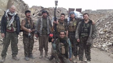 Ashley Johnston, far right, who was killed fighting Islamic State militants.