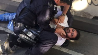 Police arrest Saeed Noori in Flinders Street on Thursday.
