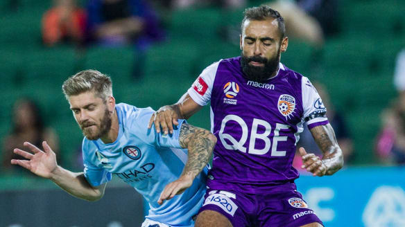City's Luke Brattan and Glory's Diego Castro  battle for possession during their round 21 clash in Perth.