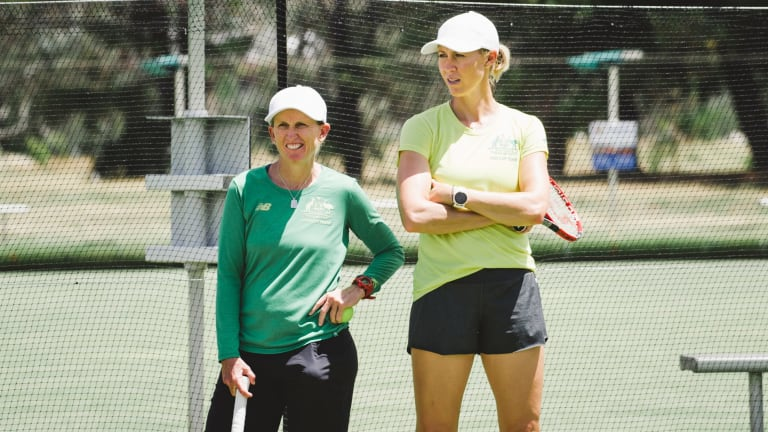 Fed Cup coach Nicole Pratt and captain Alicia Molik keep an eye on proceedings in Canberra on Monday.