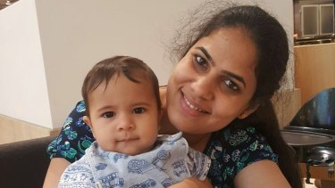 Nethra Krishnamurthy, with her eight-month-old baby boy, was critically injured in Bourke Street on Friday.