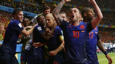The Dutch celebrate their stunning win.