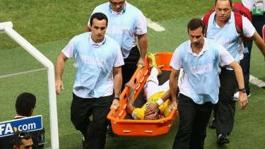 Brazil blow: Neymar is carried off on a stretcher.