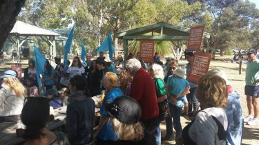 Protesters gather at Cockburn Wetlands Centre on Tuesday.