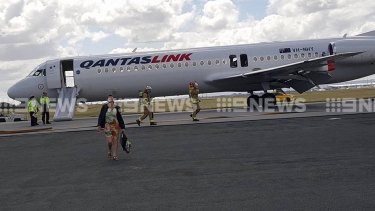 The Qantas link plane evacuated on the runway.
