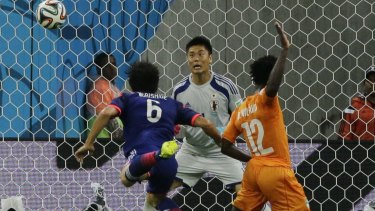 Wilfried Bony heads the equaliser for the Ivory Coast.