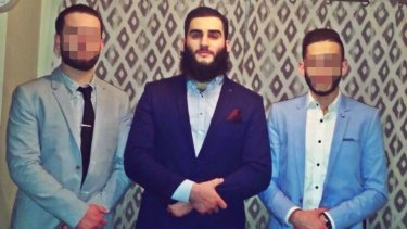 Former Epping Boys High student Tamim Khaja (centre) was arrested by counter terrorism police.