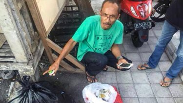 The Indonesian man who found the cut-up cards belonging to slain police officer Wayan Sudarsa in a bloodstained plastic bag.