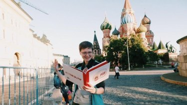 A russian LGBT activist reads <i>I Think I'm a Poof</i> in Moscow.