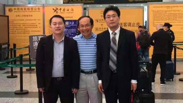 UTS academic Professor Feng Chongyi at the Guangzhou Airport on Saturday afternoon with his lawyers Chen Jingxue (left) and Liu Hao (right) after being questioned by police.