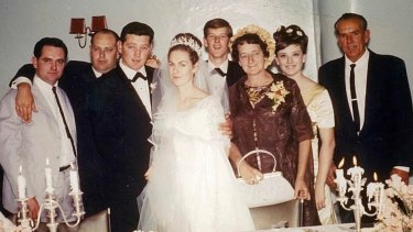 Turner (second from right) in 1966, aged 16, at brother Ray's wedding. From left: brothers Noel, Ralph and Ray, Ray's wife Val, brother Leigh, parents Isabell and Leo. This picture was taken just before a punch-up between the boys, she says.