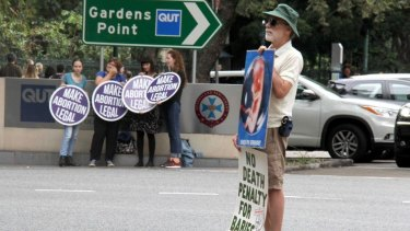 Pro- and anti-abortion protesters gathered outside Brisbane's Parliament House in May.