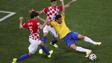 Brazil's Fred goes down under a challenge from Croatia's Dejan Lovren.