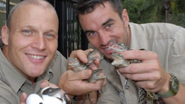 Shoalhaven Zoo owner Nick Schilko with handler Trent Burton who was bitten by a croc during a feeding show on Monday.