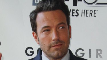 """Ben Affleck has been seen with a red and yellow phoenix tattoo that covers his entire back but claims it is """"fake""""."""