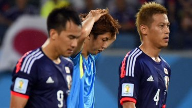 Disappointed ... Japan's forwards Shinji Okazaki, Yuya Osako and Keisuke Honda react at the end of a Group C match between Japan and Greece.