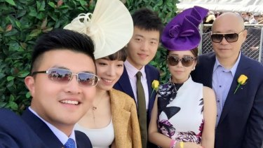 Andrews government adviser Mike Yang (left) with Tian Di (right) and Sisly Tian (second from right) at the Spring Racing Carnival in 2015.