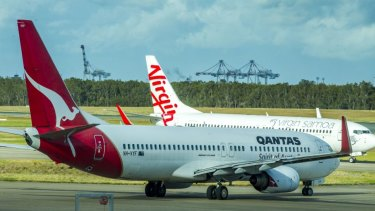 Qantas has lost corporate market share to Virgin, a survey shows.