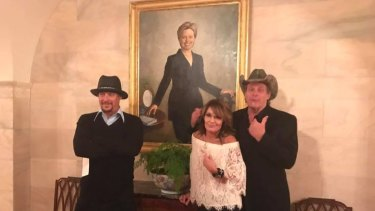 Kid Rock, Sarah Palin and Ted Nugent in front of a Hillary Clinton portrait during their White House visit.