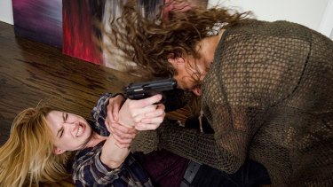 Jessie (Alexandra Breckenridge) fights off one of an invader.