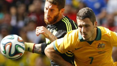 Spain's Sergio Ramos fights for the ball against Australia's Matthew Leckie.