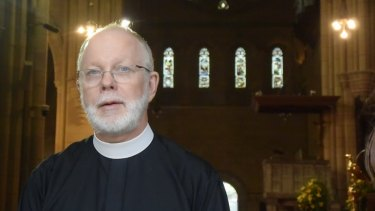 Brisbane's Anglican Dean Peter Catt says he is willing to put himself between police and asylum seekers.