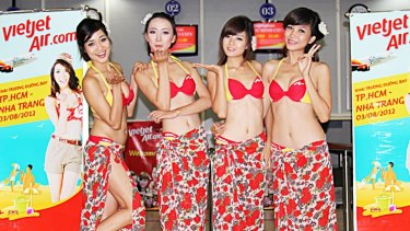 VietJet is known for its young and attractive flight attendants who wear bikinis on inaugural flights to beach locations.