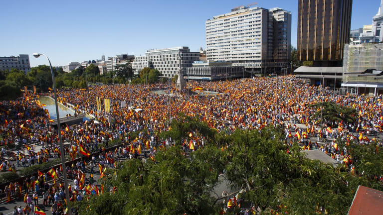 Demonstrators gather in Colon Square during a protest for Spanish unity in Madrid on Saturday.
