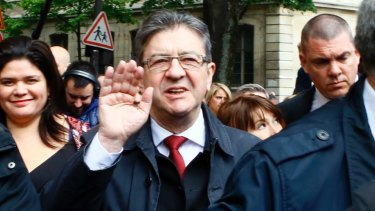 Far-left presidential candidate Jean-Luc Melenchon waves after voting in the first round of the French presidential election.