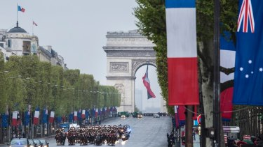The Australian flag flying alongside the French tricolour on Anzac Day.