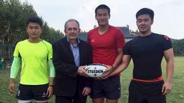 New frontier: Paul Broughton with three Chinese rugby league players.