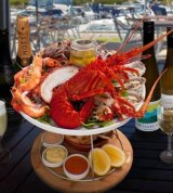 """Police allege the man consumed a """"significant"""" amount of seafood and alcohol then ran out without paying."""