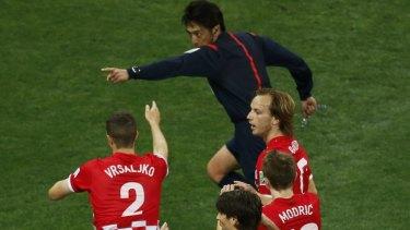 Japan's referee Yuichi Nishimura points at the penalty spot.