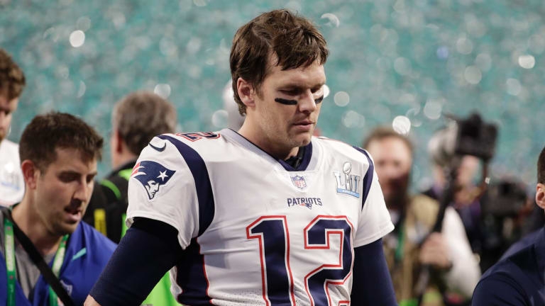 Uncertain future: Tom Brady walks off the field after losing the Super Bowl.
